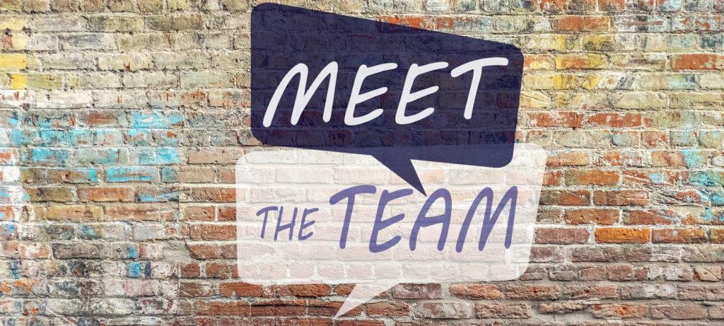 Meet the team graffiti on a brick wall