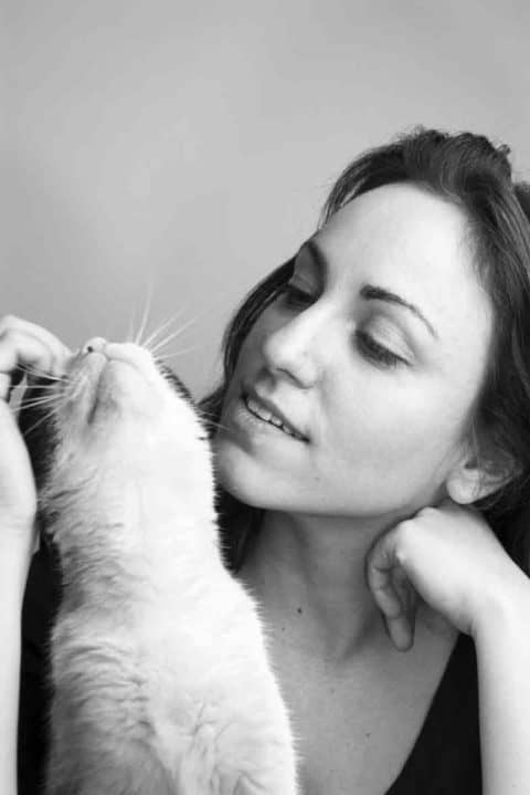 Black and white picture of a lady with her cat being stroked